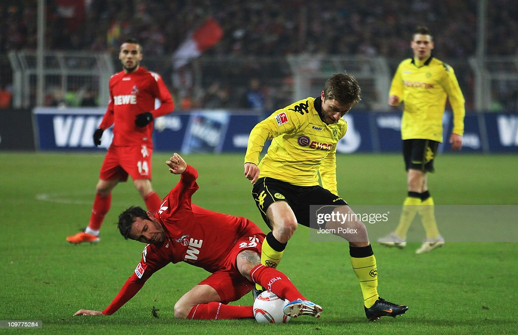 Kuba of Dortmund and <a gi-track='captionPersonalityLinkClicked' href=/galleries/search?phrase=Fabrice+Ehret&family=editorial&specificpeople=754522 ng-click='$event.stopPropagation()'>Fabrice Ehret</a> of Koeln battle for the ball during the Bundesliga match between Borussia Dortmund and 1. FC Koeln at Signal Iduna Park on March 4, 2011 in Dortmund, Germany.