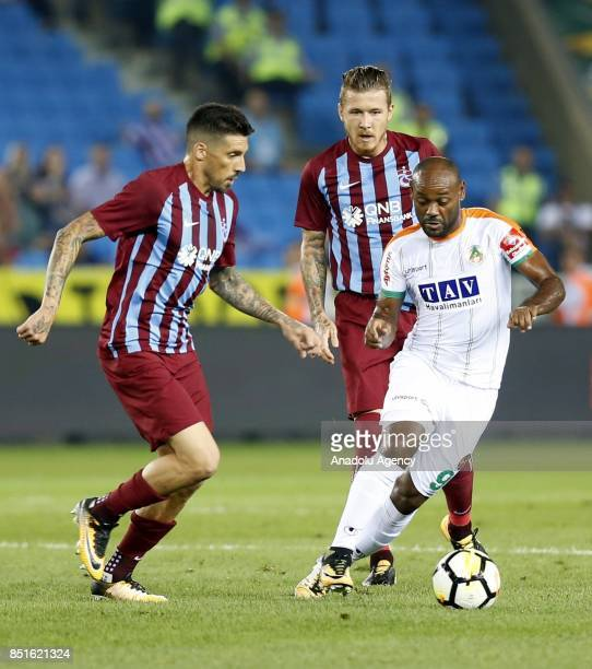Kucka and Sosa of Trabzonspor in action against Vagner Silva of Aytemiz Alanyaspor during the Turkish Super Lig week 6 soccer match between...