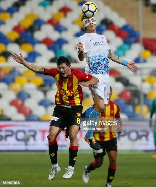 Kucka of Trabzonspor in action against Castro Pereira of Goztepe during the Turkish Super Lig soccer match between Goztepe and Trabzonspor at the...
