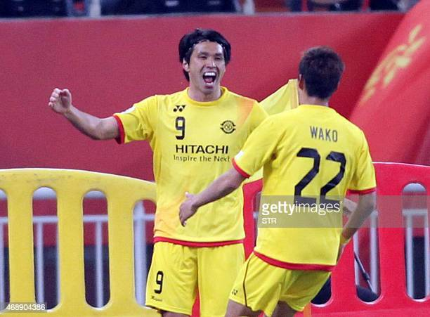 Kudo Masato of Japan's Kashiwa Reysol celebrates after scoring a goal against China's Shandong Luneng FC during their AFC Champions League group E...