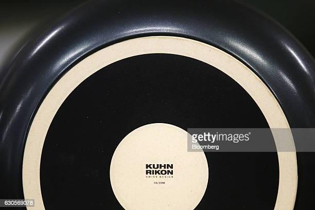 A Kuhn Rikon logo sits on the underside of a fondue pan inside the Kuhn Rikon AG factory in Rikon im Tosstal near Winterthur Switzerland on Friday...