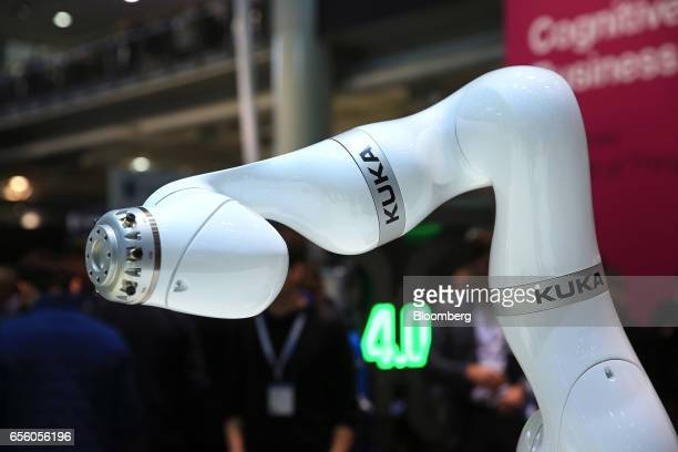 A Kuka AG robotic arm demonstrates its movement capabilities at the CeBIT 2017 tech fair in Hannover Germany on Tuesday March 21 2017 Leading edge...