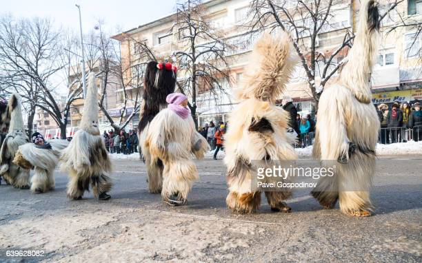 Kukeri And Other Costumed Bulgarians Dancing During A Traditional Kukeri Festival
