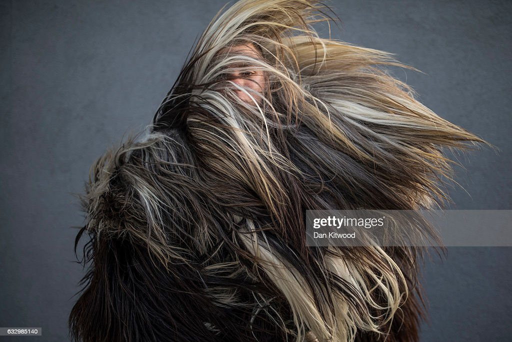A Kukeri performer checks the fit on his costume by shaking it around ahead of the start of the second and final day of the annual Surva International Festival of the Masquerade Games on January 29, 2017 in Pernik, Bulgaria. The two day Surva festival is the largest traditional folklore events of this type across the whole Balkan Peninsula. Around 6000 people from every folklore region of Bulgaria, participate in the pagan event which sees masked Kukers, (mummers) and Survakari dancers, as well as costumed pagan dancers from across the wider region parade through the city streets. The Kukeri tradition is included in UNESCOÕs list of protected non-material cultural heritage.