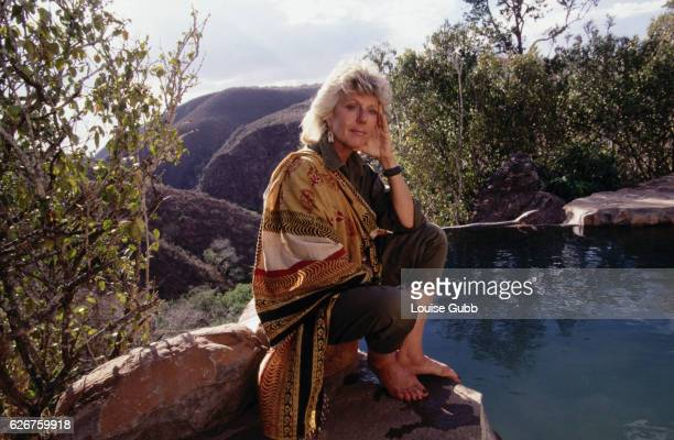 Kuki Gallmann wildlife conservationist by a swimming pool shelter at Mukutan retreat She was portrayed by Kim Basinger in the film 'I Dreamed of...