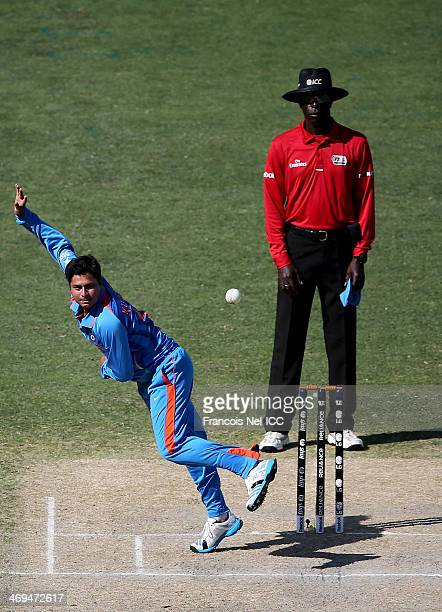 Kuldeep Yadav of India bowls during the ICC U19 Cricket World Cup 2014 match between India and Pakistan at the Dubai Sports City Cricket Stadium on...