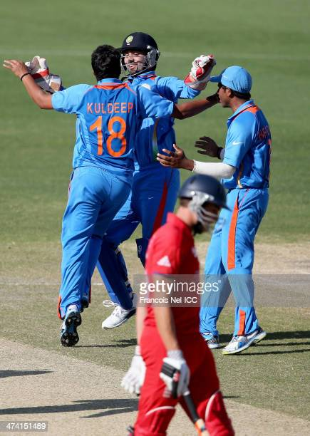 Kuldeep Yadav of India celebrate with teammates after dismissing Ben Duckett during the ICC U19 Cricket World Cup 2014 Quarter Final match between...