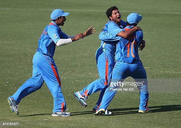 Kuldeep Yadav of India celebrate with teammates during the ICC U19 Cricket World Cup 2014 Quarter Final match between England and India at the Dubai...