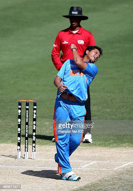 Kuldeep Yadav of India celebrates with teammates after dismissing Nick Farrar of Scotland during the ICC U19 Cricket World Cup 2014 match between...