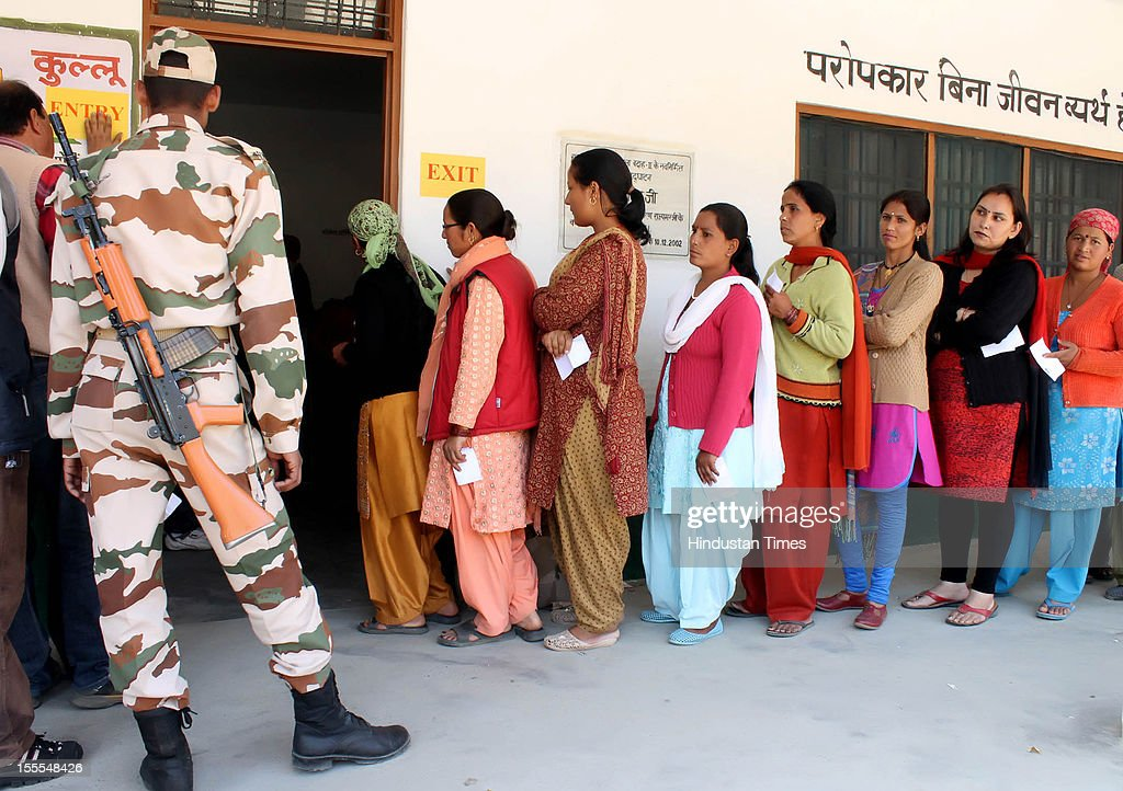 Kullu people queue at a polling station to vote in the Himachal Assembly election on November 04, 2012 in Himachal Pardesh, India. Voting figures have indicated a high percentage turnout for polling in the assembly election.