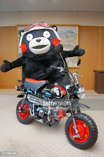 Kumamon official mascot of Kumamoto prefecture poses with Honda Motor Co's mini bike 'Monkey Kumamon version' or 'Kumamonkey' during its launching at...