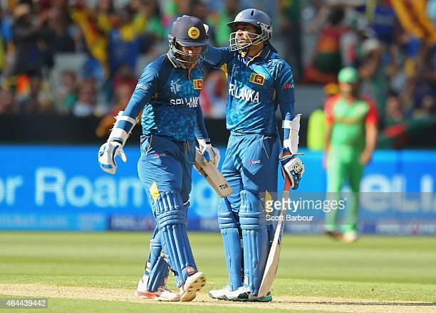 Kumar Sangakkara and Tillakaratne Dilshan of Sri Lanka congratulate each other during the 2015 ICC Cricket World Cup match between Sri Lanka and...