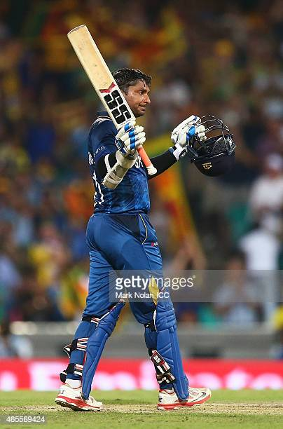 Kumar Sangakkara of Sri Lanka celebrates and acknowledges the crowd after scoring a century during the 2015 ICC Cricket World Cup match between...
