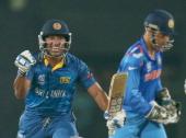 Kumar Sangakkara of Sri Lanka celebrates in the final over as MS Dhoni of India looks on during the Final of the ICC World Twenty20 Bangladesh 2014...