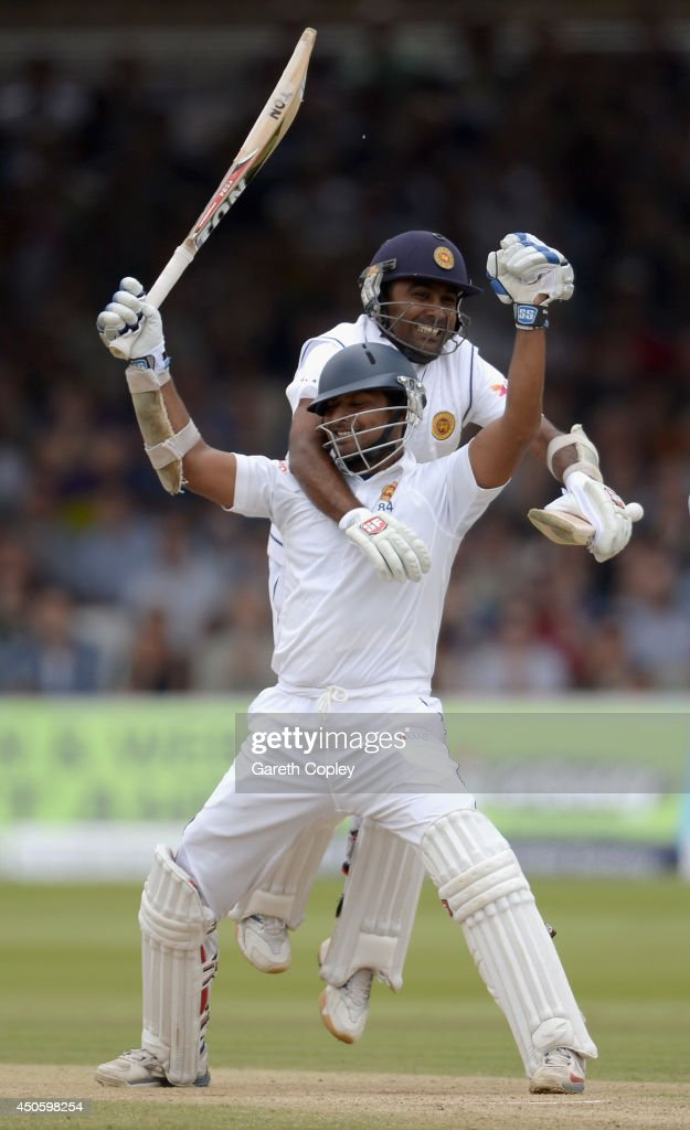 <a gi-track='captionPersonalityLinkClicked' href=/galleries/search?phrase=Kumar+Sangakkara&family=editorial&specificpeople=206804 ng-click='$event.stopPropagation()'>Kumar Sangakkara</a> of Sri Lanka celebrates reaching his century with teammate Mahela Jayawardena during day three of 1st Investec Test match between England and Sri Lanka at Lord's Cricket Ground on June 14, 2014 in London, England.