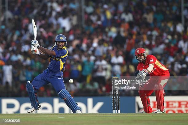 Kumar Sangakkara of Sri Lanka hits to the offside as wicketkeeper Ashish Bagai looks on during the Sri Lanka v Canada 2011 ICC World Cup Group A...