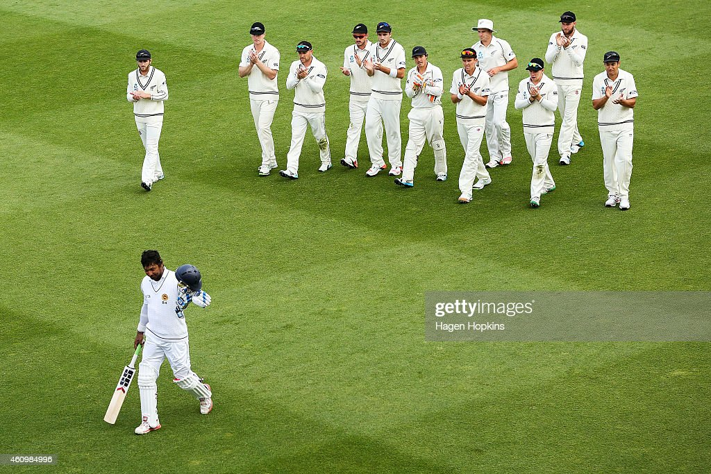<a gi-track='captionPersonalityLinkClicked' href=/galleries/search?phrase=Kumar+Sangakkara&family=editorial&specificpeople=206804 ng-click='$event.stopPropagation()'>Kumar Sangakkara</a> of Sri Lanka is applauded by New Zealand players as he leaves the field at the end of play after surpassing 12,000 test runs during day one of the Second Test match between New Zealand and Sri Lanka at Basin Reserve on January 3, 2015 in Wellington, New Zealand.