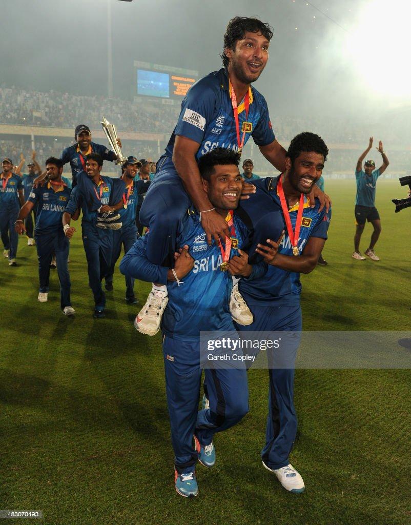 Kumar Sangakkara of Sri Lanka is chaired from the field by Seekuge Prasanna and Kusal Perera after winning the ICC World Twenty20 Bangladesh 2014 Final between India and Sri Lanka at Sher-e-Bangla Mirpur Stadium on April 6, 2014 in Dhaka, Bangladesh.