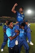 Kumar Sangakkara of Sri Lanka is chaired from the field by Seekuge Prasanna and Thisara Perera after winning the ICC World Twenty20 Bangladesh 2014...