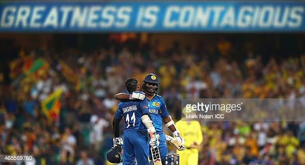 Kumar Sangakkara of Sri Lanka is congratulated by captain Angelo Mathews after he scored a century during the 2015 ICC Cricket World Cup match...