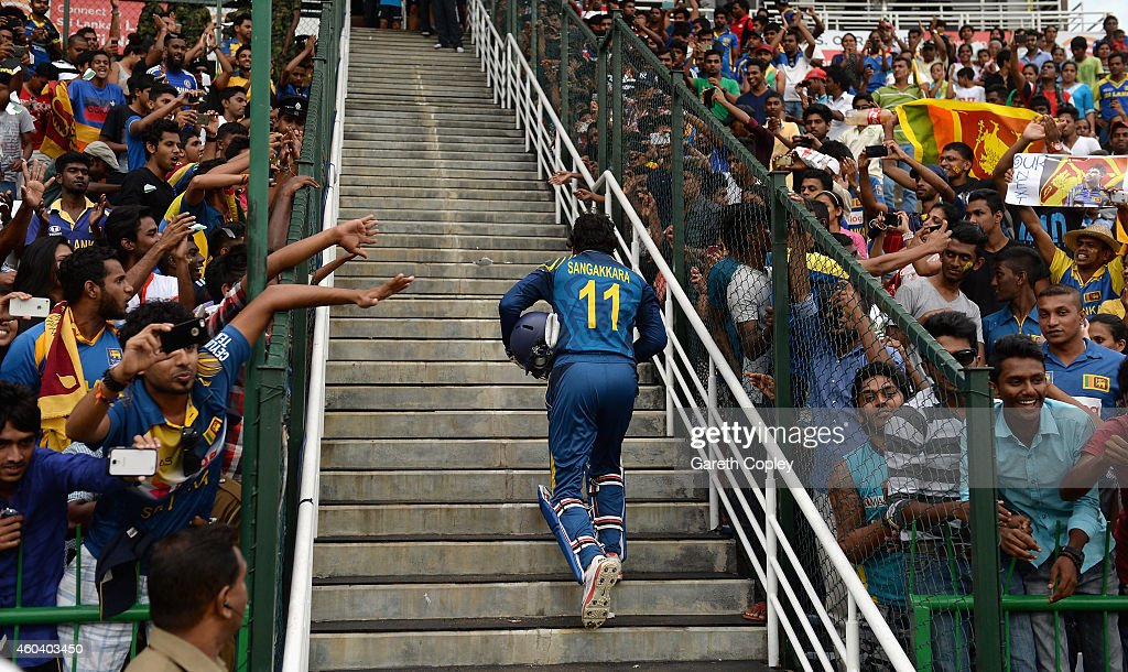 <a gi-track='captionPersonalityLinkClicked' href=/galleries/search?phrase=Kumar+Sangakkara&family=editorial&specificpeople=206804 ng-click='$event.stopPropagation()'>Kumar Sangakkara</a> of Sri Lanka leaves the field after winning the 6th One Day International match between Sri Lanka and England at Pallekele Cricket Stadium on December 13, 2014 in Kandy, Sri Lanka.