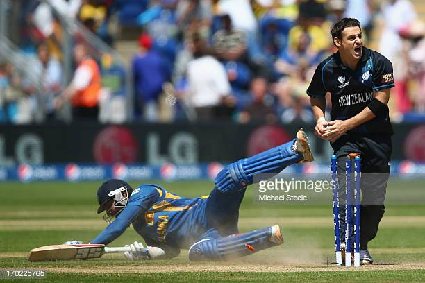 Kumar Sangakkara of Sri Lanka makes his ground as Nathan McCullum of New Zealand removes the bails during the Group A ICC Champions Trophy match...