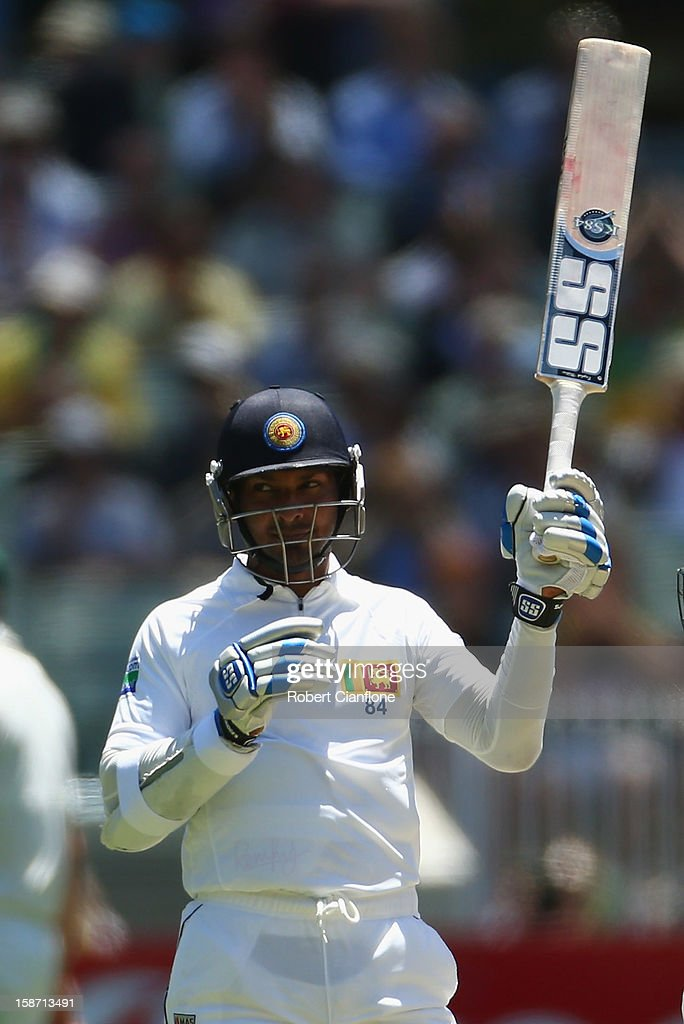 Kumar Sangakkara of Sri Lanka raises his bat after reaching tenthousand career runs during day one of the Second Test match between Australia and Sri Lanka at Melbourne Cricket Ground on December 26, 2012 in Melbourne, Australia.