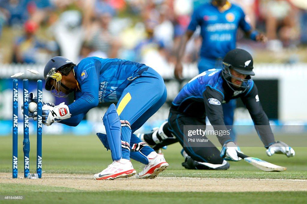 Kumar Sangakkara of Sri Lanka runs out Daniel Vettori of New Zealand during the One Day International match between New Zealand and Sri Lanka at Seddon Park on January 15, 2015 in Hamilton, New Zealand.