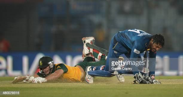 Kumar Sangakkara of Sri Lanka runs out David Miller of South Africa during the ICC World Twenty20 Bangladesh 2014 Group 1 match between Sri Lanka and...