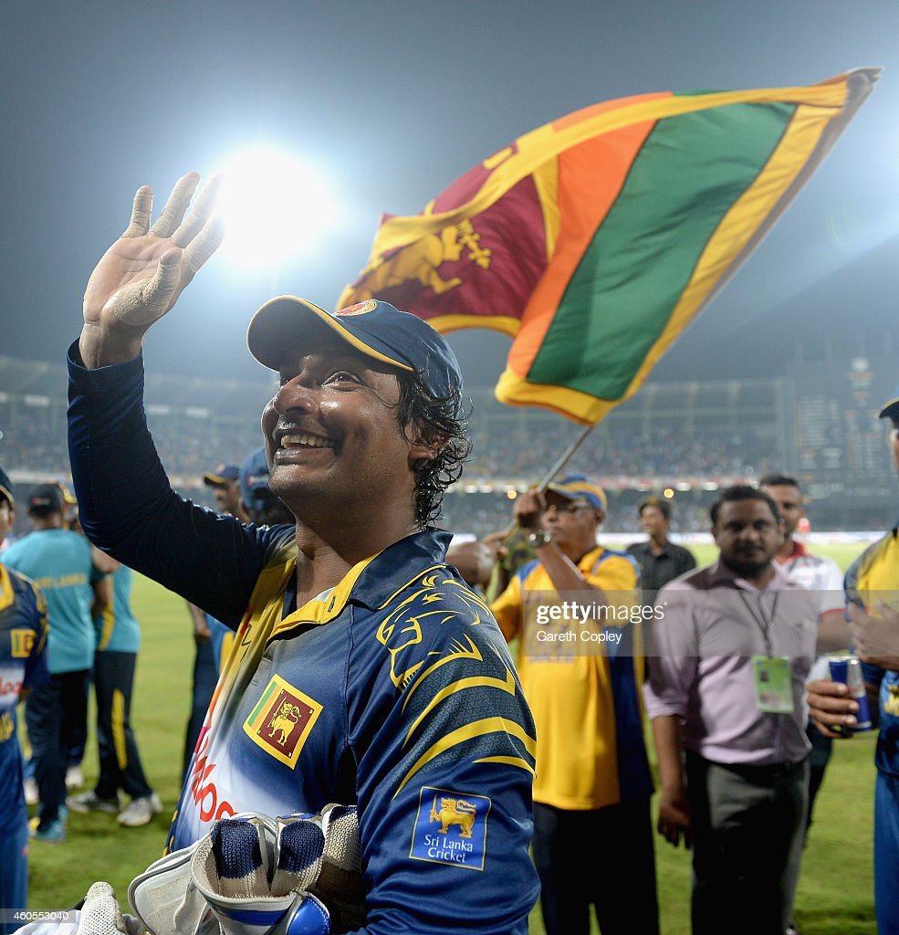 Kumar Sangakkara of Sri Lanka waves the crowd after winning the 7th One Day International match between Sri Lanka and England at R. Premadasa Stadium on December 16, 2014 in Colombo, Sri Lanka.