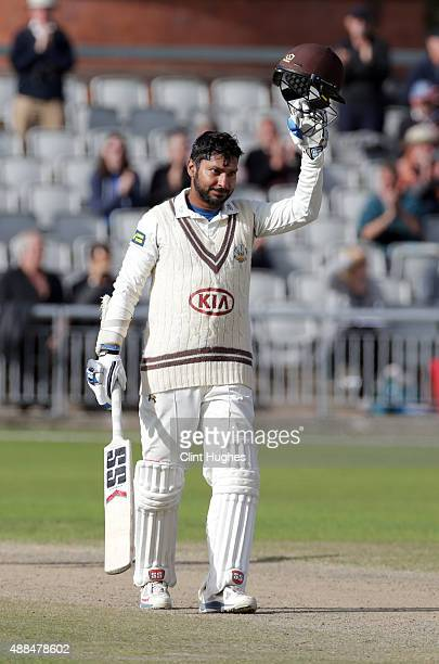 Kumar Sangakkara of Surrey celebrates after he reaches his century during day three of the LV County Championship Division Two match between...