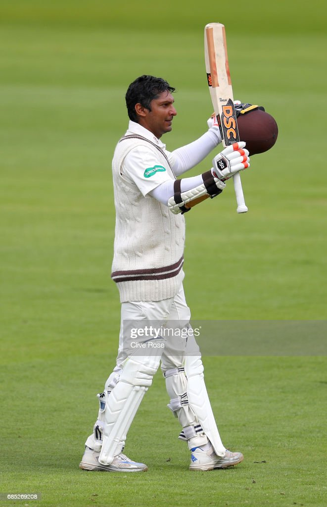 Kumar Sangakkara of Surrey celebrates his century during the Specsavers County Championship Division One match between Middlesex and Surrey at Lord's Cricket Ground on May 19, 2017 in London, England.