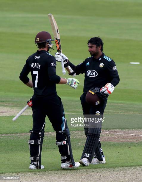 Kumar Sangakkara of surrey celebrates his century with Ben Foakes during the Royal London OneDay Cup Play Off between Yorkshire Vikings and Surrey at...