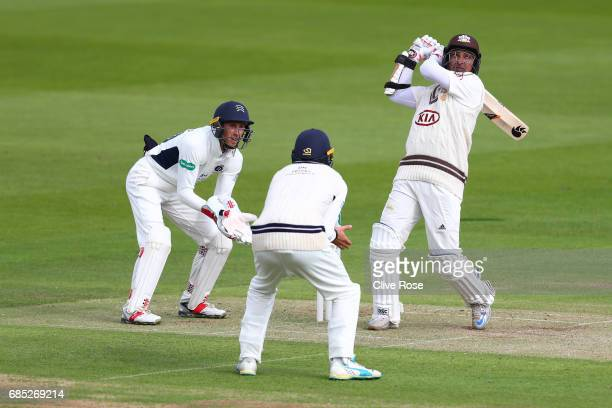 Kumar Sangakkara of Surrey hits a six during the Specsavers County Championship Division One match between Middlesex and Surrey at Lord's Cricket...