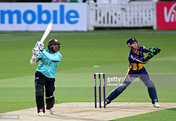 Kumar Sangakkara of Surrey hits the ball for four runs during the NatWest T20 blast match between Surrey and Glamorgan at the Kia Oval Cricket Ground...