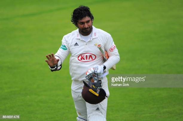 Kumar Sangakkara of Surrey is applauded off the pitch after his last innings during the County Championship Division One match between Lancashire and...