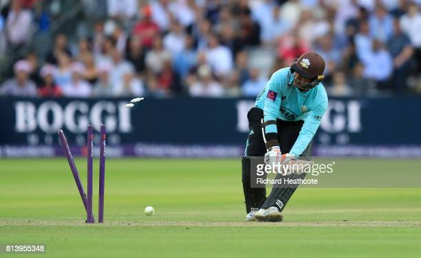 Kumar Sangakkara of Surrey is bowled out attempting a ramp shot by Steven Finn of Middlesex during the NatWest T20 Blast match between Middlesex and...