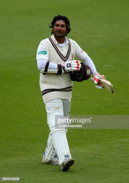 Kumar Sangakkara of Surrey makes his way off the field after being caught out Jack Leach of Somerset for 157 during day three of the Specsavers...