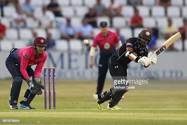 Kumar Sangakkara of Surrey plays to the legside as wicketkeeper Adam Rossington of Northants looks on during the Royal London OneDay Cup Quarter...