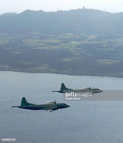 Kumejima Japan Two P3C Orion surveillance planes operated by Japan's Maritime SelfDefense Force fly over the sea off Kume Island in the Japanese...