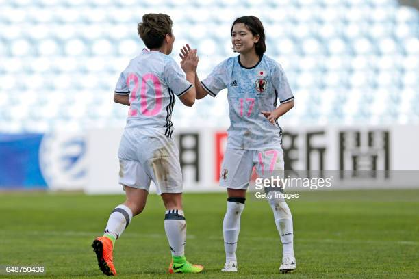 Kumi Yokoyama and Yui Hasegawa of Japan celebrate their goal during the match between Norway v Japan Women's Algarve Cup on March 6 2017 in Loule...