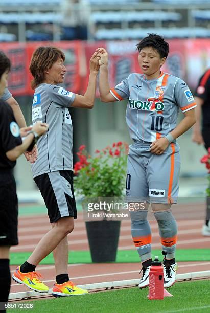 Kumi Yokoyama of AC Nagano Parceiro celebrates scoring her team's first goal with her team's head coach Midori Honda during the Nadeshiko League...