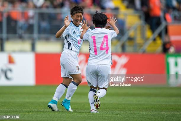 Kumi Yokoyama of Japan celebratea with Yu Nakasato of Japan after scoring her teams first goal during the Women's International Friendly match...