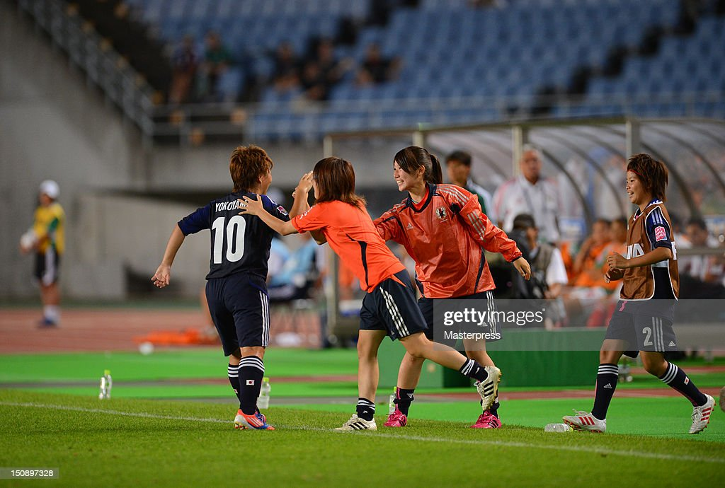 <a gi-track='captionPersonalityLinkClicked' href=/galleries/search?phrase=Kumi+Yokoyama&family=editorial&specificpeople=7180346 ng-click='$event.stopPropagation()'>Kumi Yokoyama</a> (1L) of Japan celebrates scoring their third goal with her team mates during the FIFA U-20 Women's World Cup Group A match between Japan and Mexico at Miyagi Stadium on August 19, 2012 in Rifu, Miyagi, Japan.