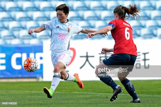 Kumi Yokoyama of Japan challenges Maren Mjelde of Norway during the match between Norway v Japan Women's Algarve Cup on March 6 2017 in Loule Portugal