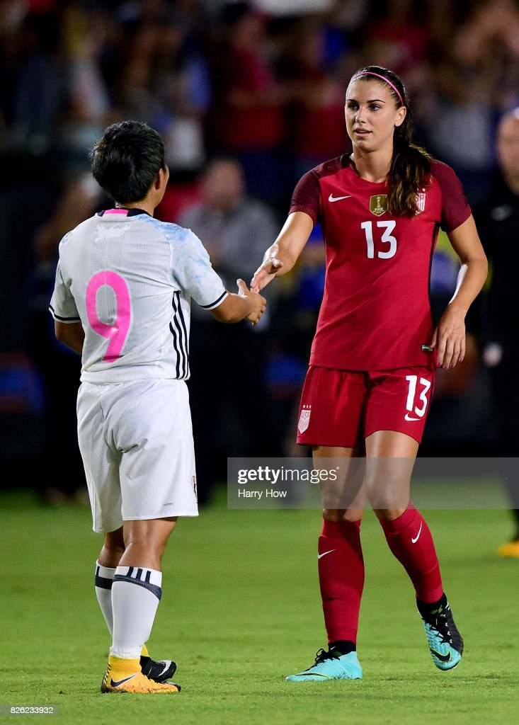 Kumi Yokoyama #9 of Japan shakes hands with Alex Morgan after a 3-0 after a 3-0 loss to the United Stated during the 2017 Tournament Of Nations at StubHub Center on August 3, 2017 in Carson, California.