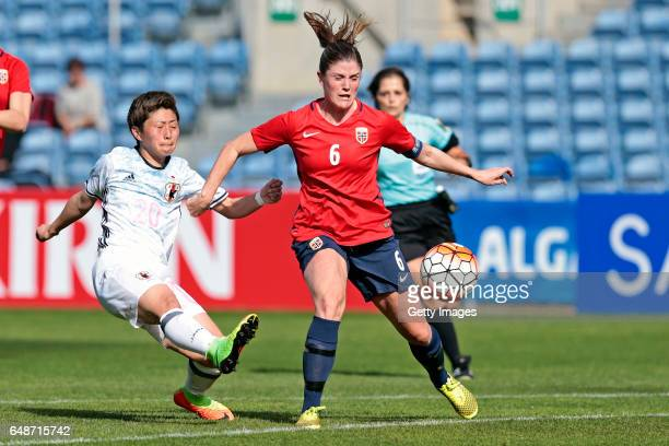 Kumi Yokoyama of Japan Women challenges Maren Mjelde of Norway Women during the match between Norway v Japan Women's Algarve Cup on March 3rd 2017 in...