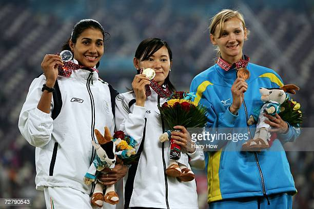 Kumiko Ikeda of Japan celebrates gold Anju Bobby George of India silver and Olga Rypakova of Kazakhstan bronze in the Women's Long Jump Medal...