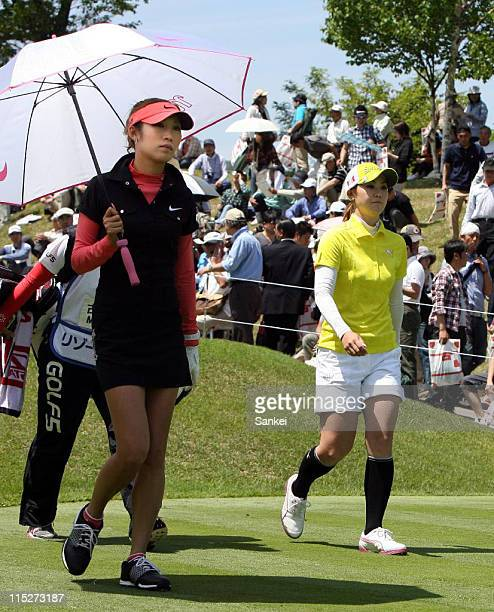 Kumiko Kaneda and Miho Koga walk on the fiarway during the second round of the Resort Trust Ladies at Grandee Karuizawa Golf Club on June 4 2011 in...