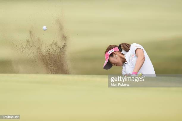 Kumiko Kaneda of Japan hits out of the 1st green bunker during the final round of the World Ladies Championship Salonpas Cup at the Ibaraki Golf Club...
